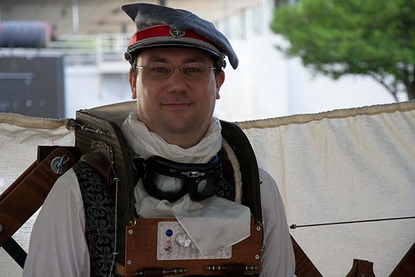 Steampunk costumer with wooden backpack ensemble