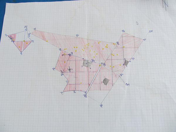 Photograph of a hand drawn map on graph paper.