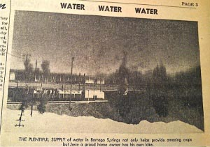 """Photograph of a newspaper clipping that contains a photo with the heading """"Water Water Water"""""""
