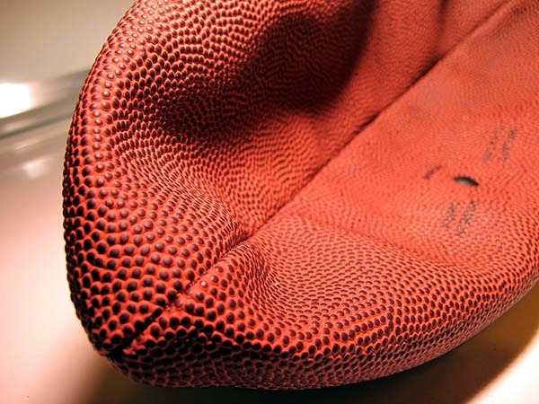 A close-up photograph of a deflated football.
