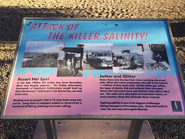 "A placard at the Salton Sea State Recreation Area explains the transformation from ""resort hot spot"" to salt lake."