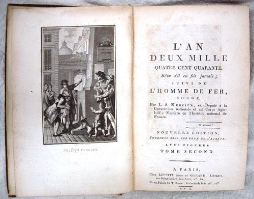 Photograph of an old book. There is an illustration of men on the left side and the title page on the right.