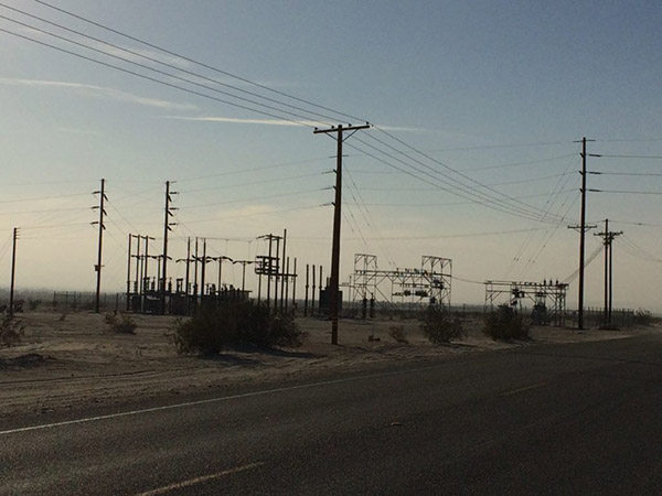 An electrical substation weathers the clouds of dust kicked up by a nearby off-road vehicle recreation area. Photo by author.