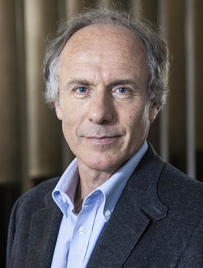 Portrait of Dr. Alan Finkel in a blue dress shirt and jacket facing the camera.