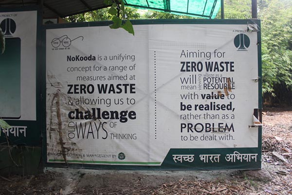 """A sign that says """"NoKooda is a unifying concept for a range of measures aimed at zero waste & allowing us to challenge old ways of thinking. Aiming for zero waste will mean viewing waste as a potential resource with value to be realised, rather than a problem to be dealt with."""""""