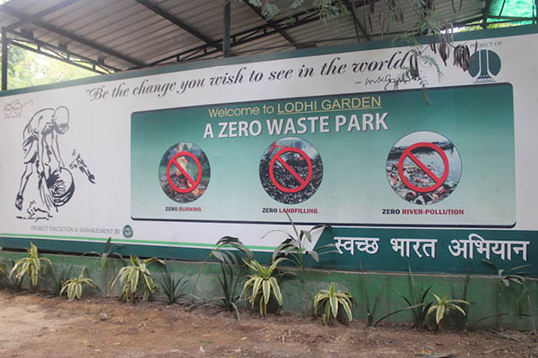 """A sign that says """"Be the change you wish to see in the world. Welcome to Lodhi Garden. A zero waste park."""""""