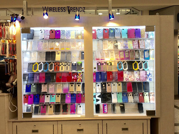 An image of two display cases at a mall kiosk, containing a colorful array of cell phone cases.