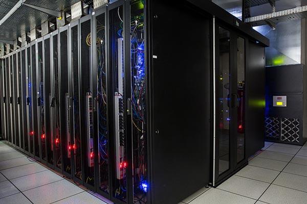 A photograph of servers on server racks in a data center server room.