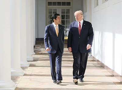 Shinzo Abe and Donald Trump, walking together and speaking