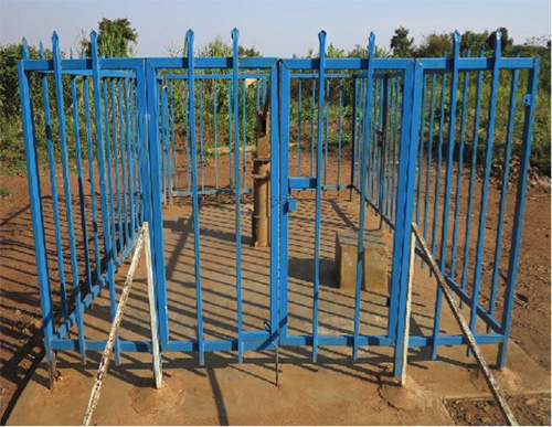 Photograph of blue fencing.
