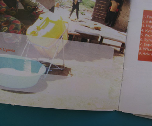Photograph of a booklet. On the left page is a photograph of a person pouring water from a yellow jug into a teal bowl.