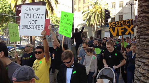 """Demonstrators march with signs in front of the 2014 Oscars. The signs read """"Chase talent not subsididies"""" and """"Respect VFX""""."""