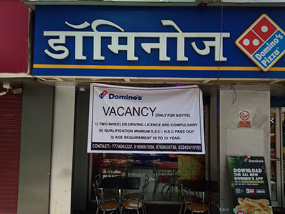 A banner outside a Domino's pizza franchise in India seeking delivery personel reads: VACANCY: (Only for boyys)