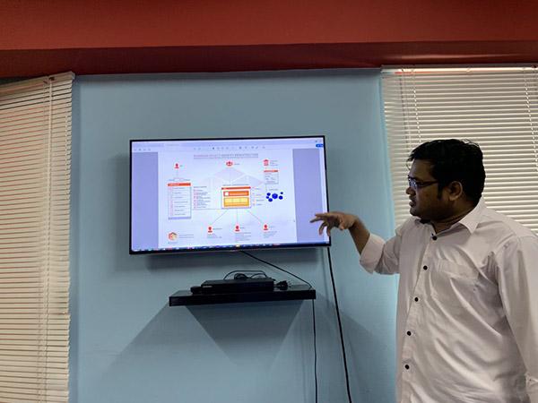 Man explaining blockchain on computer monitor