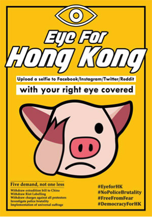 "A yellow poster that says ""Eye for Hong Kong. Upload a selfie to Facebook/Instagram/Twitter/Reddit with your right eye covered."" There is a cartoon pig head covering its right eye with its hoof."