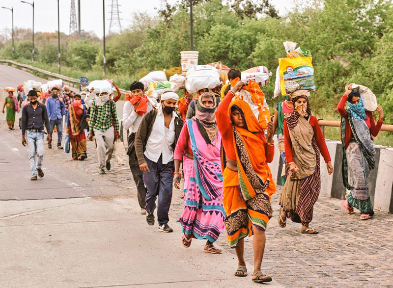 Migrant workers in India, during COVID-19 lockdown period  walking back from the cities on foot in the absence of any public transport, to reach to their villages in different states.