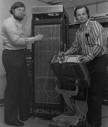 Thomas Knight and Richard Greenblat stand next to LISP computer they developed