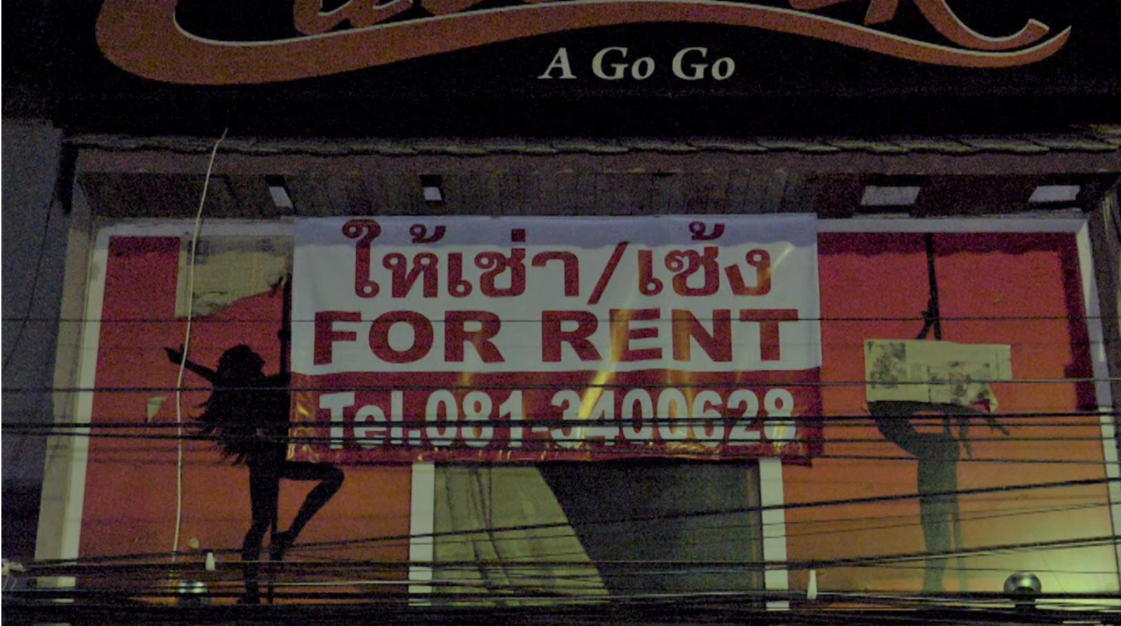 "A go-go bar on Walking Street in Pattaya with a sign reading ""For Rent"". Many bars and nightlife venues have been transformed into makeshift housing. Photo Credit: Sky News."