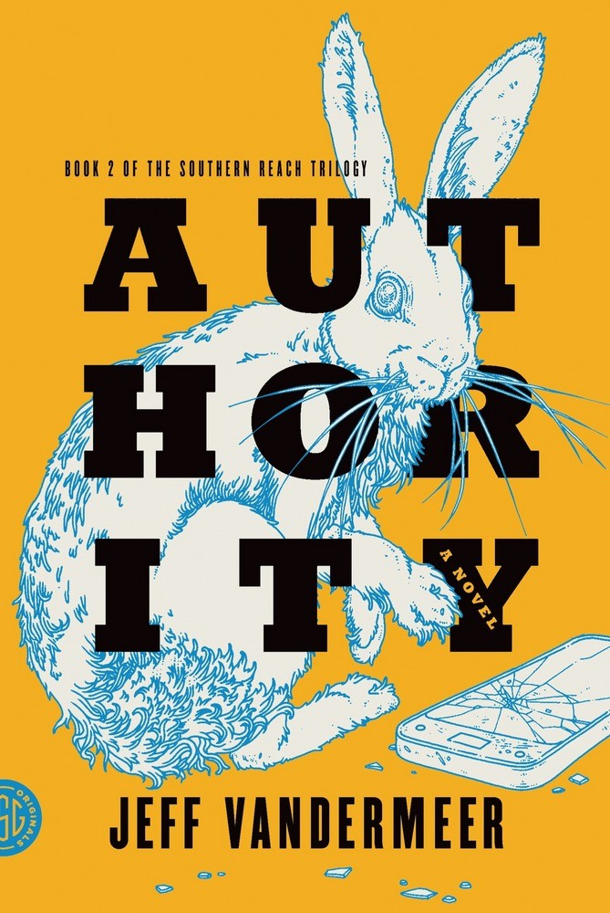 """Оранжевая обложка книги """"Власть"""" Джефа Вандермеера. Название разбито на три строчки по три черные буквы в строчке. Название переплетено с картинкой бело-синего кролика, который сидит рядом с разбитым смартфоном."""