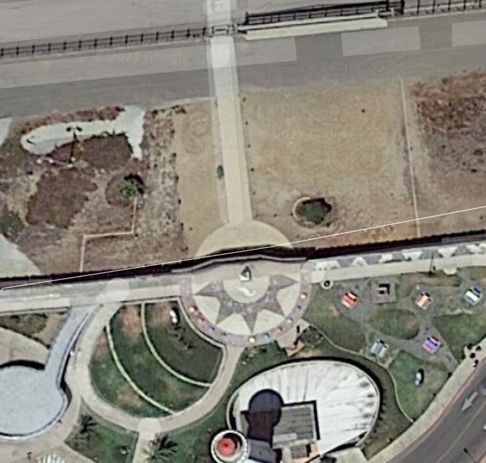 Aerial view showing two border walls parallel to each other bisecting Friendship Park and El Parque de La Amistad.