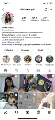 ID: Screenshot of an Instagram Profile of creator named Ishita Mangal with tile of pictures of her collaborations beneath a description of her interests.