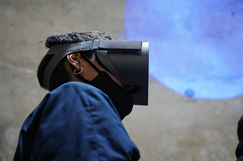 A person wearing a VR equipment on their face.