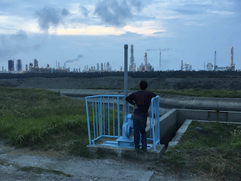 A businessman looks over the horizon to observe the Naphtha Sixth Cracking Plant in Mailiao, Yunlin, Taiwan.