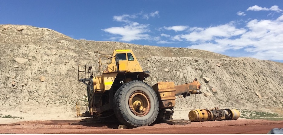 A photo of a mine truck in decay on a coal mine site