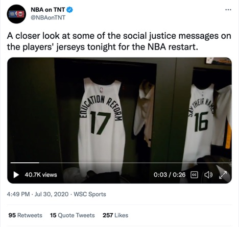"""Still image from a video tweeted by @NBAonTNT of two basketball jerseys hanging in a locker room. One jersey reads: """"Education Reform"""" and the other reads """"Say their names."""""""